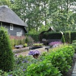 Romantic garden with small classic pond and flowerbeds-roses and ornamental grasses-FLORERA tuinen ea. buitenruimtes
