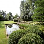 Landscape garden with waterponds for koi and bridge-maintenance friendly-Florera landscaping.