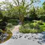 weergaloze unieke landelijk tuin met organische vijver via tuinontwerp florera tuinen