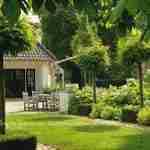 Doordacht exclusief tuinontwerp landelijke tuin met weergaloos beplantingsplan
