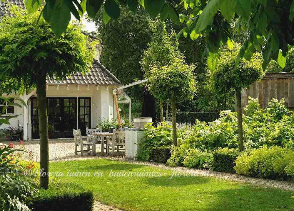 Landelijke tuin laten ontwerpen aanleggen door for Tuin inrichten planten