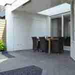 overdekt terras en kleuradvies muren loungetuin